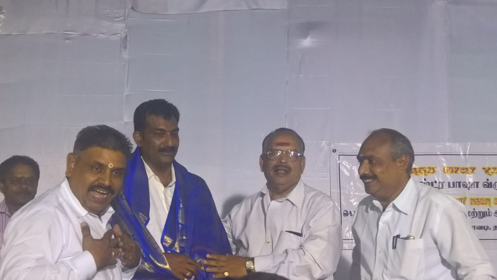 Mr. Arjuna Krishnaram getting appreciation for the complete organisation of bhasha vridhi mandal function